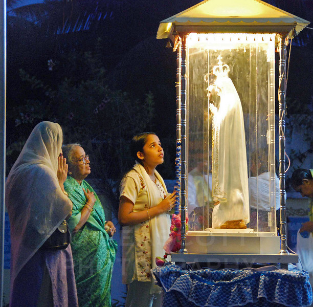 Three generations of Catholic parishioners pray in Cochin, India.