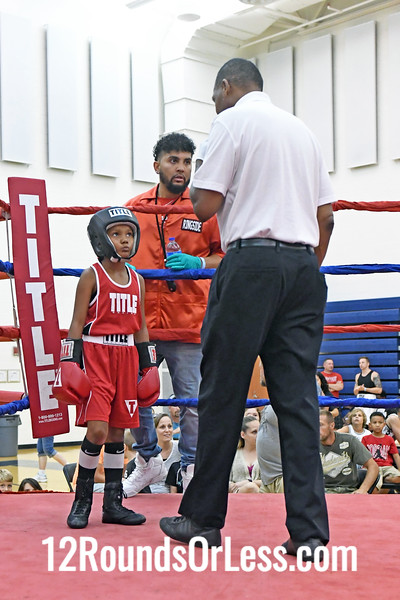 Bout #1:  Zion Hensley, Blue Gloves, Youngstown vs Phoenix Brownfield, Red Gloves, Safinaw, MI, 65 Lbs