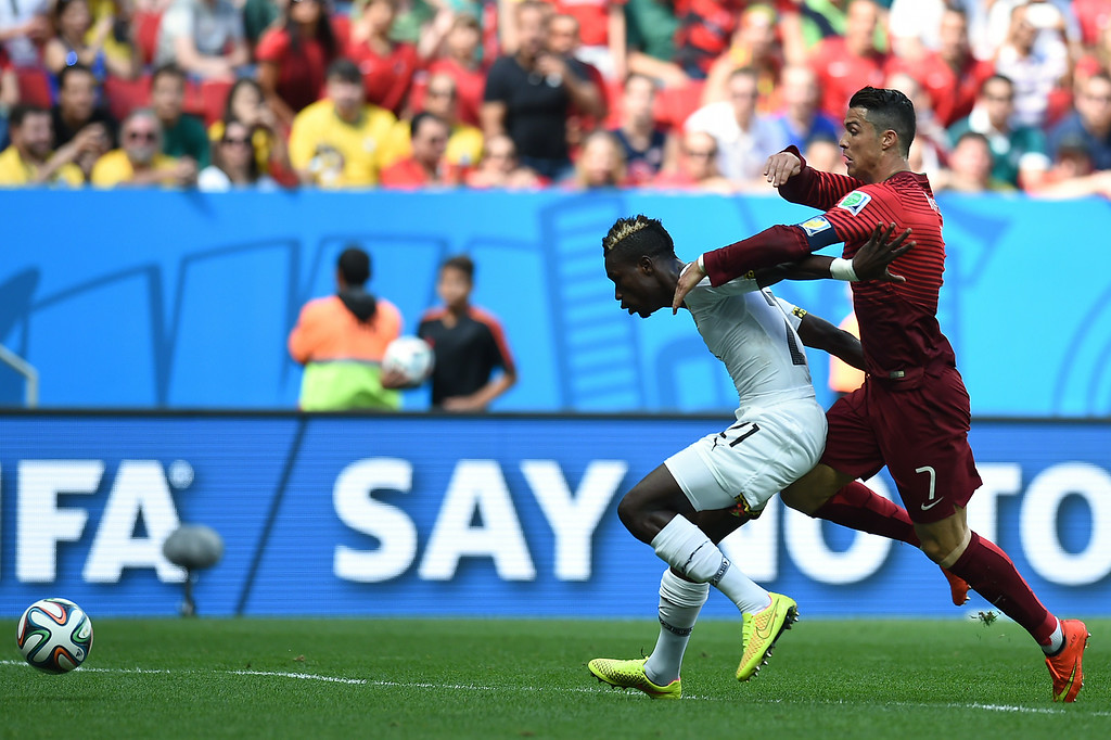 . Portugal\'s forward and captain Cristiano Ronaldo (R) and Ghana\'s defender John Boye vie for the ball during the Group G football match between Portugal and Ghana at the Mane Garrincha National Stadium in Brasilia during the 2014 FIFA World Cup on June 26, 2014. CARL DE SOUZA/AFP/Getty Images