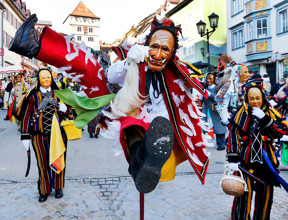. A \'Federahannes\', a jester figure from Rottweil, is participating in the \'Narrensprung\' (jester jump) parade in Rottweil, southern Germany, Monday, Feb. 27, 2016. About 4000 jesters paraded through the city among thousands of spectators. The Rottweil Narrensprung is the highlight of the Swabian-Alemannic Fastnacht and one of the traditional pre-Lenten carnival parades in the south. (AP Photo/Michael Probst)