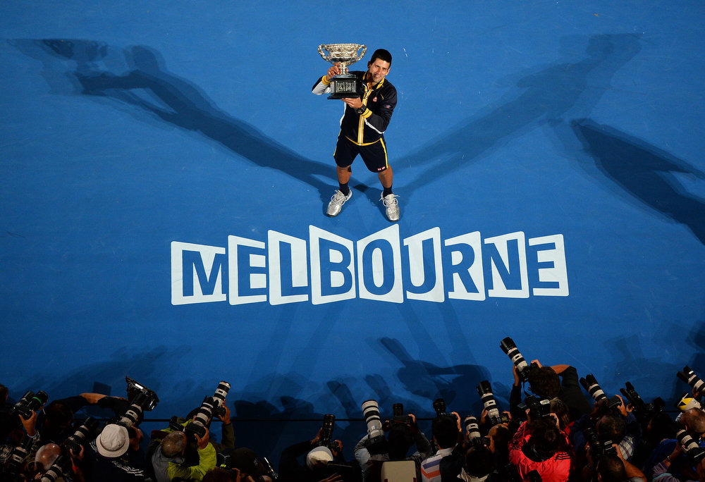. Serbia\'s Novak Djokovic poses with the winner\'s trophy after his victory over Britain\'s Andy Murray during the men\'s singles final on day 14 of the Australian Open tennis tournament in Melbourne on January 27, 2013.  WILLIAM WEST/AFP/Getty Images