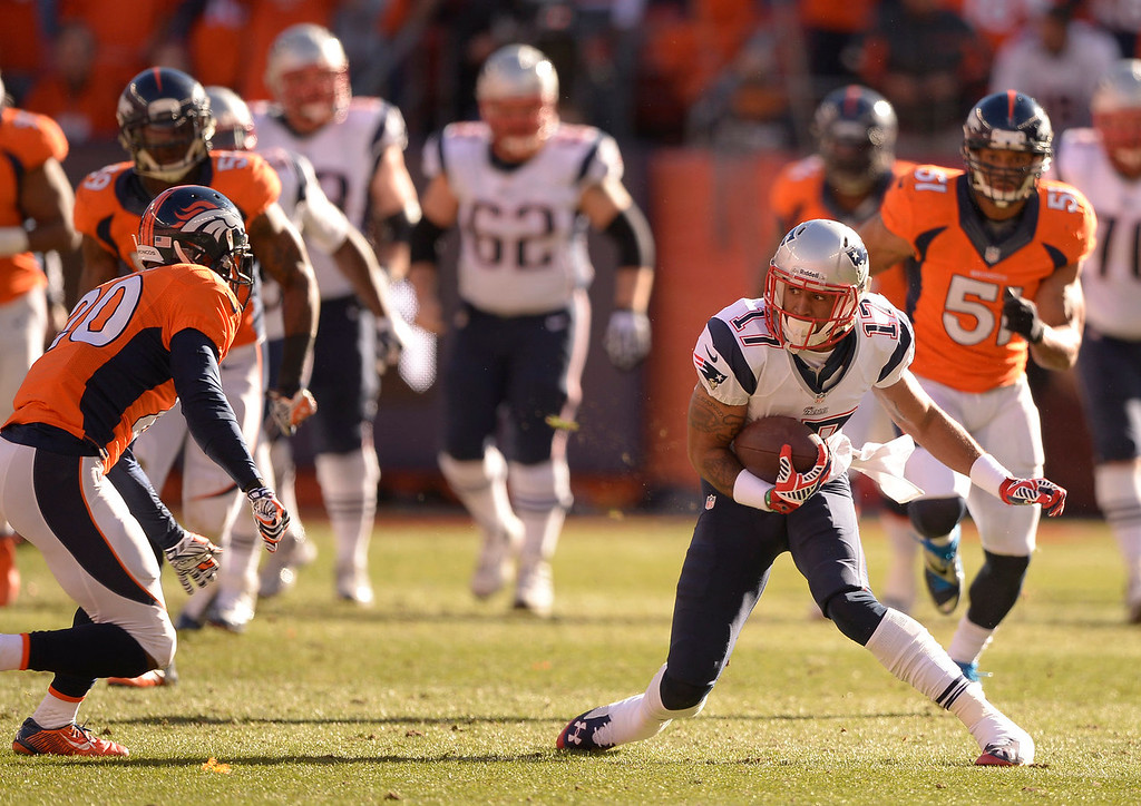. New England Patriots wide receiver Aaron Dobson (17) has second thoughts as Denver Broncos free safety Mike Adams (20) comes up on him during the second quarter. The Denver Broncos vs. The New England Patriots in an AFC Championship game  at Sports Authority Field at Mile High in Denver on January 19, 2014. (Photo by John Leyba/The Denver Post)