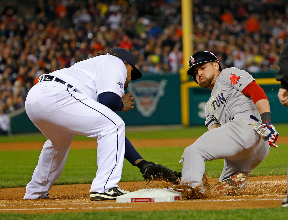 . Boston Red Sox\'s Jacoby Ellsbury is safe at first in the third inning as Detroit Tigers first baseman Prince Fielder tags him during Game 4 of the American League baseball championship series Wednesday, Oct. 16, 2013, in Detroit. (AP Photo/Paul Sancya)