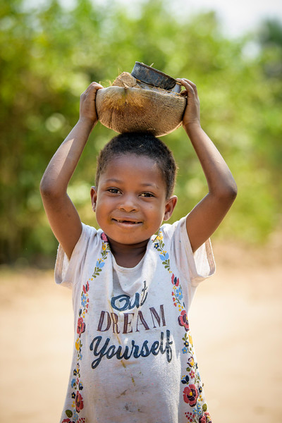 """Little girl wearing  a t-shirt that says, """"out Dream Yourself"""", Nganza, Kananga, DRC."""