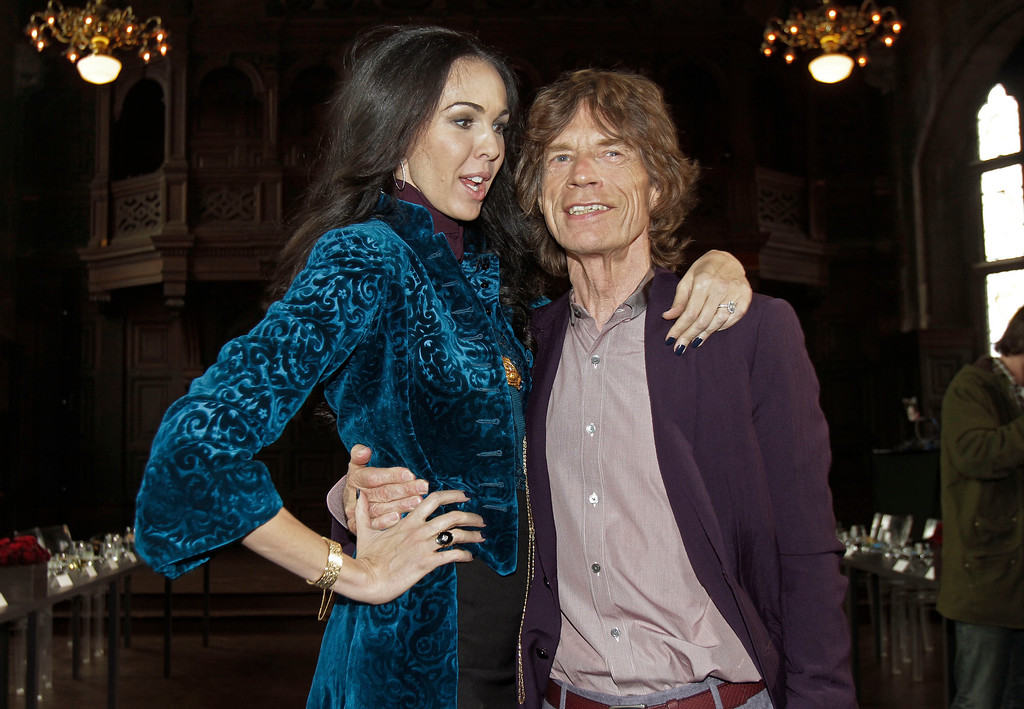 . FILE - This Feb. 16, 2012 file photo shows singer Mick Jagger, right, with designer L�Wren Scott after her Fall 2012 collection was modeled during Fashion Week, in New York. Scott was found dead Monday, March 17, 2014, in Manhattan of a possible suicide. (AP Photo/Richard Drew, File)