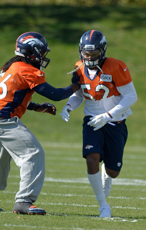 . Denver Broncos outside linebacker Wesley Woodyard (52) runs through drills with Denver Broncos outside linebacker Nate Irving (56) October 16, 2013 at Dove Valley. (Photo by John Leyba/The Denver Post)