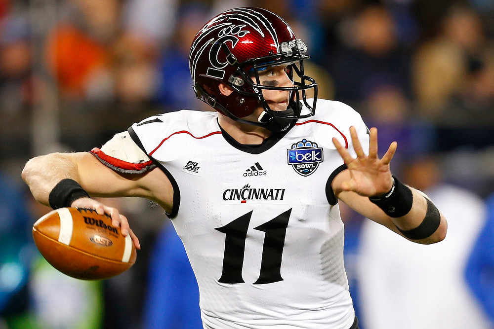 . Cincinnati\'s Brendon Kay (11) looks to pass against Duke during the first half of the Belk Bowl NCAA college football game in Charlotte, N.C., Thursday, Dec. 27, 2012. (AP Photo/Chuck Burton)