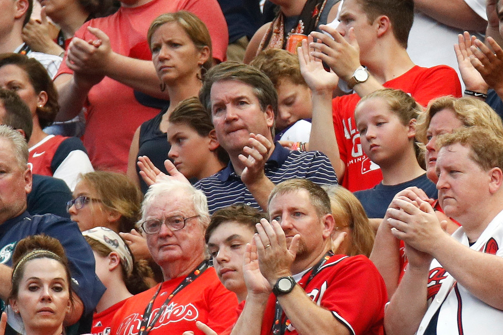 . CORRECTS SPELLING TO KAVANAUGH, INSTEAD OF KAVANUAGH - Supreme Court nominee Brett Kavanaugh, center, watches events on the field from the stands before the Major League Baseball All-Star Game, Tuesday, July 17, 2018, in Washington.(AP Photo/Patrick Semansky)