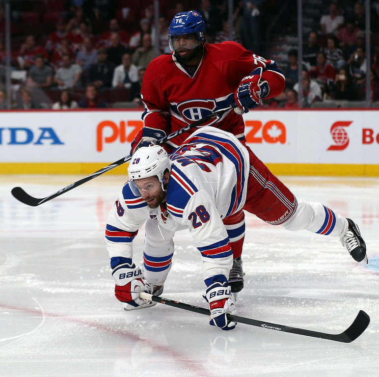 . Subban #76 of the Montreal Canadiens checks Dominic Moore #28 of the New York Rangers during Game Two of the Eastern Conference Final during the 2014 Stanley Cup Playoffs at Bell Centre on May 19, 2014 in Montreal, Canada.  (Photo by Bruce Bennett/Getty Images)