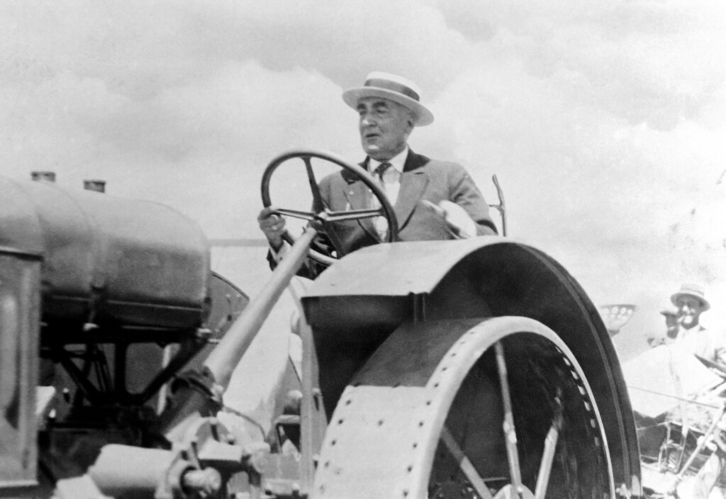 . President Warren Harding rides a tractor in 1923. (AP Photo)
