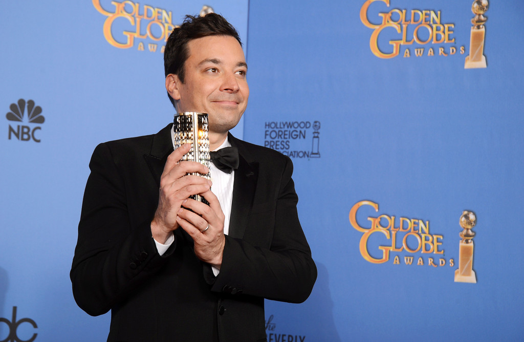. Jimmy Fallon poses in the press room at the 71st annual Golden Globe Awards at the Beverly Hilton Hotel on Sunday, Jan. 12, 2014, in Beverly Hills, Calif. (Photo by Jordan Strauss/Invision/AP)