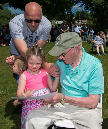 05/27/19 Wesley Bunnell | Staff Bristol held Memorial Day ceremonies on Monday morning ending with a ceremony which presented World War II veterans with All Heart Awards from the city. Antonio Benvenuto shows his award to his great granddaughter Margaret McNamara, age 3.