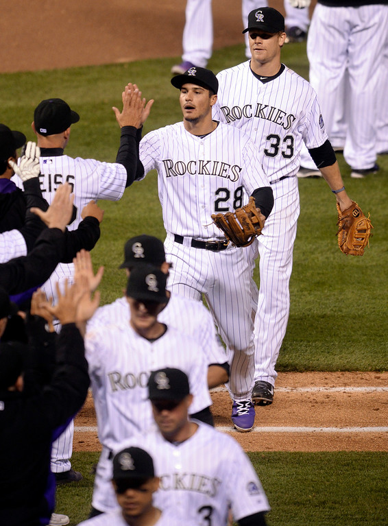 . DENVER, CO - APRIL 5:  Manager Walt Weiss high-rived infielder Nolan Arenado after the win. The Colorado Rockies defeated the Arizona Diamondbacks 9-4 Saturday night, April 5, 2014 in Denver. (Photo by Karl Gehring/The Denver Post)