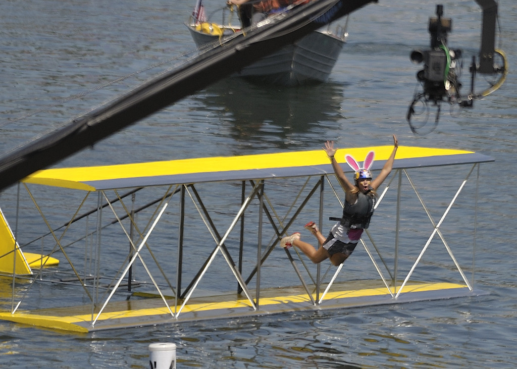 """. LONG BEACH, CALIF. USA -- Corinne Schnieders celebrates after her team\'s Flugtag entry \""""Peepin\' it Real\"""" went 96 feet to win the event in Rainbow Harbor in Long Beach, Calif. on August 21, 2010. Thirty five teams competed in the Red Bull event where teams build homemade, human-powered flying machines and pilot them off a 30-foot high deck in hopes of achieving flight.  Flugtag means \""""flying day\"""" in German. They are on distance, creativity and showmanship..Photo by Jeff Gritchen / Long Beach Press-Telegram.."""