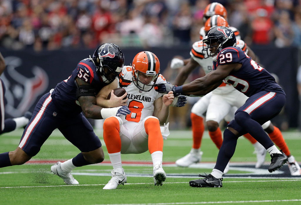 . Cleveland Browns quarterback Kevin Hogan (8) its stopped by Houston Texans linebacker Benardrick McKinney (55) and safety Andre Hal (29) after picking up first down running the ball in the first half of an NFL football game, Sunday, Oct. 15, 2017, in Houston. (AP Photo/Eric Gay)