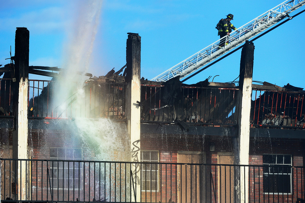 . DENVER, CO - APRIL 1: A rainbow appears while firefighters try to extinguish a fire at the former Rockies Inn near I-25 and Evans Avenue on April 1, 2016 in Denver, Colorado. The fire, that started in the late afternoon, destroyed the vacant motel causing a wall to fall onto an adjacent building. No injuries were reported. (Photo by Brent Lewis/The Denver Post)
