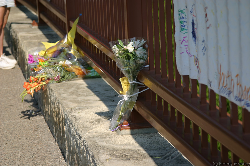 Flowers and other memorials are in several places along the Stone Arch Bridge