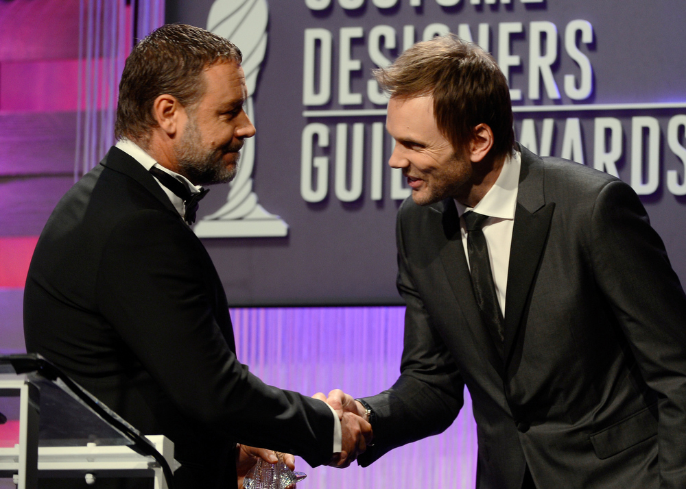 Description of . Presenter Russell Crowe and host Joel McHale onstage during the 15th Annual Costume Designers Guild Awards with presenting sponsor Lacoste at The Beverly Hilton Hotel on February 19, 2013 in Beverly Hills, California.  (Photo by Frazer Harrison/Getty Images for CDG)