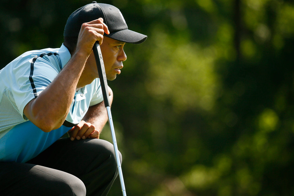 . Tiger Woods lines up his putt on the 14th green during the first round of the PGA Championship golf tournament at Oak Hill Country Club, Thursday, Aug. 8, 2013, in Pittsford, N.Y. (AP Photo/The Buffalo News, Derek Gee)