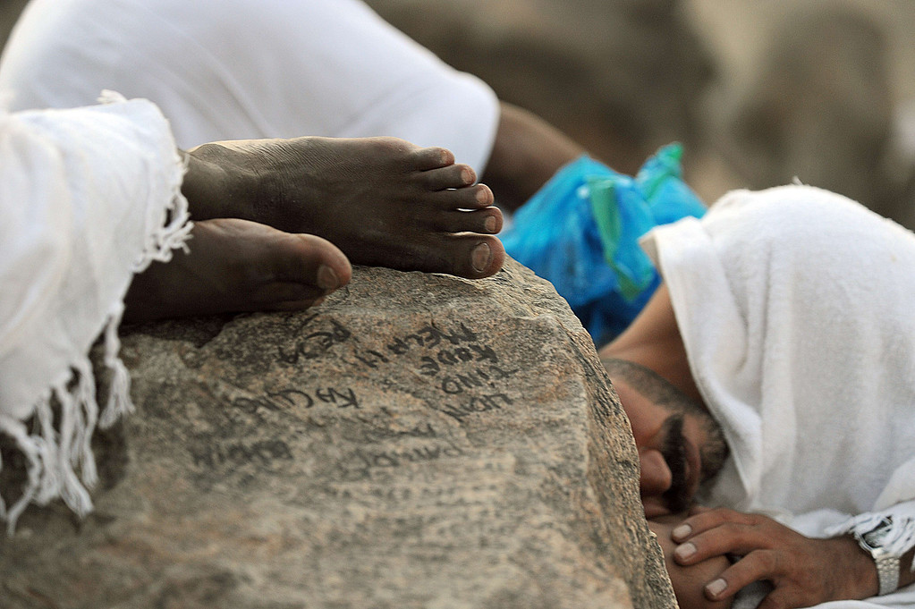 . Muslim pilgrims rest on Mount Arafat, near the holy city of Mecca, ahead of the hajj main ritual, on October 14, 2013.  AFP PHOTO/FAYEZ NURELDINE/AFP/Getty Images