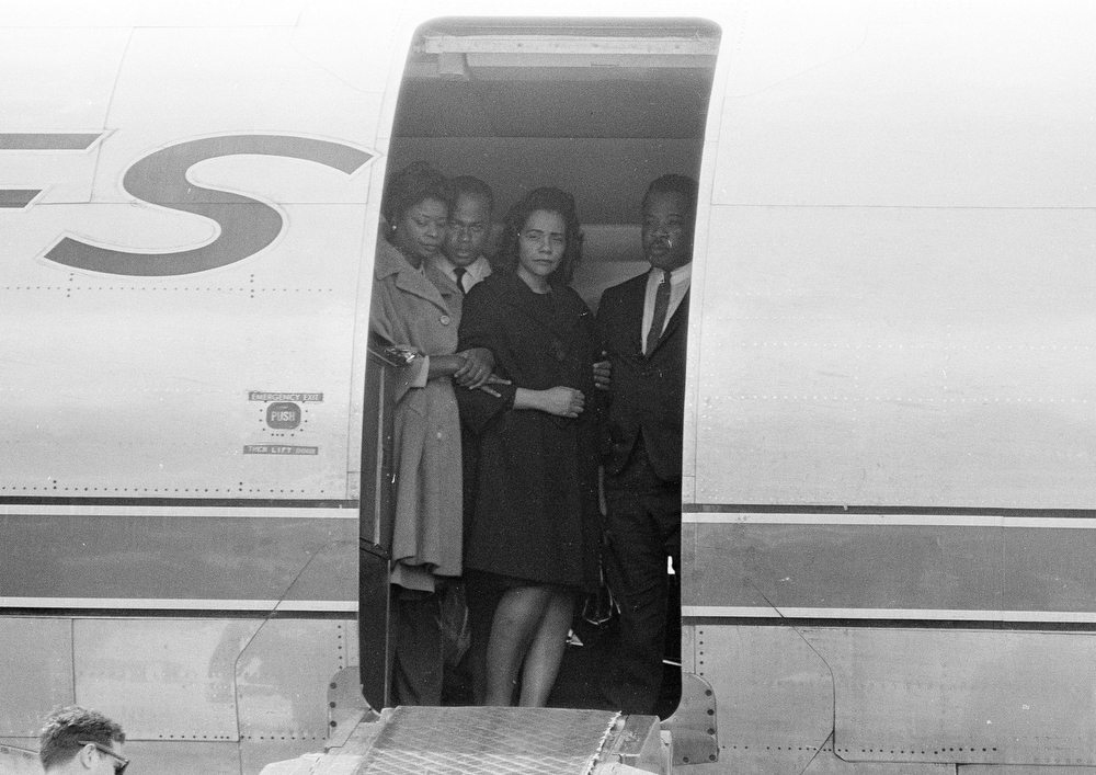 . FILE - Coretta Scott King, center, widow of slain civil rights leader Dr. Martin Luther King, Jr., is comforted in the doorway of an airliner in Memphis, Tenn., April 5, 1968, as her husband\'s body is brought up the ramp.   The civil rights leader was standing on the balcony of the Lorraine Motel when he was killed by a rifle bullet on April 4, 1968. James Earl Ray pleaded guilty to the killing and was sentenced to 99 years in prison. He died in prison in 1998.  (AP Photo)