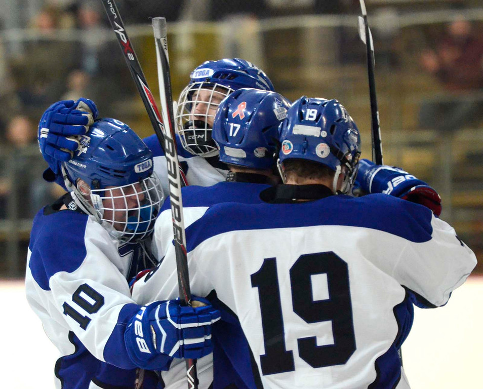 . Ed Burke - The Saratogian 12/07/13 Saratoga\'s Devin Coffey, center facing, celebrates with fellow Blue Streaks after scoring against St. Joseph\'s during Saturday\'s action in the Don Kauth Memorial Tournament at Saratoga Springs Ice Rink.