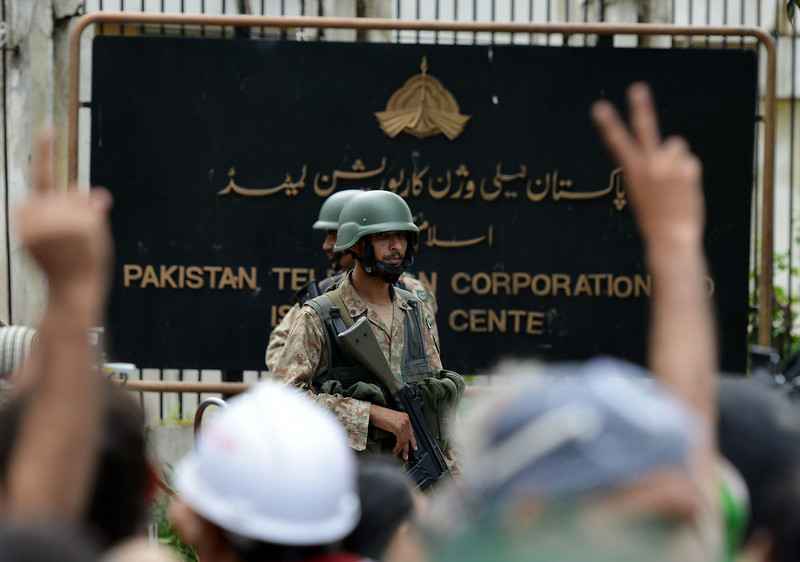 . Pakistani soldiers stand guard outside the headquarters of state-owned Pakistani Television (PTV) after the building was stormed by supporters of Canadian cleric Tahir ul Qadri and cricket-turned politician Imran Khan during anti-government protests in Islamabad on September 1, 2014. Hundreds of protesters trying to topple Pakistan\'s government stormed the state broadcaster on September 1 as fresh clashes with police broke out in Islamabad. AAMIR QURESHI/AFP/Getty Images