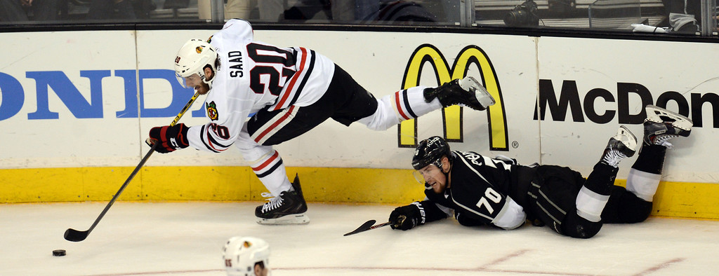 . The Blackhawks� Brandon Saad #20 gets away form the Kings\' Tanner Pearson #70 during Game 6 of the Western Conference finals at the Staples Center on Friday, May 30, 2014. The Blackhawks beat the Kings 4-3. (Photo by Hans Gutknecht/Los Angeles Daily News)
