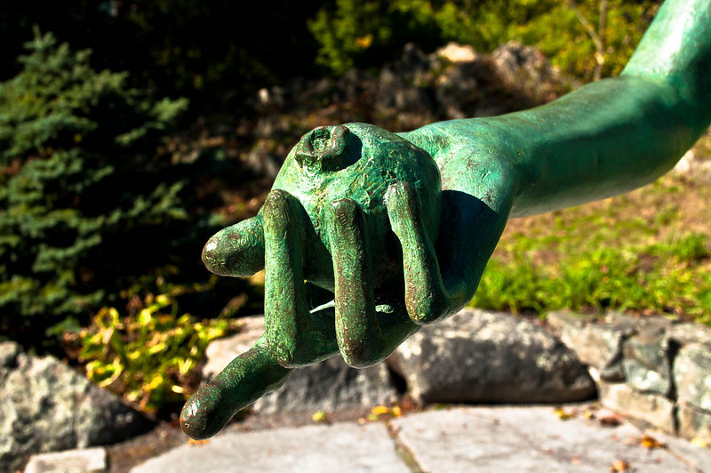 """Close-up of Eve's hand holding THE apple from Marianna Pineda's sculpture """"Eve Celebrated"""" at the Decordova Museum and Sculpture Park"""