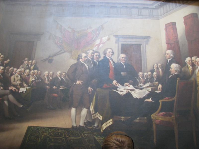 A REENACTMENT of the signing of the Declaration of Independence. This is the picture on the back of the $2 bill