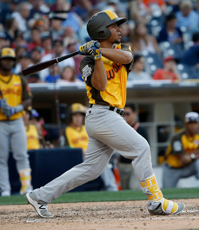 . World Team\'s Carlos Asuaje, of the San Diego Padres, hits against the U.S. Team during the eighth inning of the All-Star Futures baseball game, Sunday, July 10, 2016, in San Diego. (AP Photo/Lenny Ignelzi)