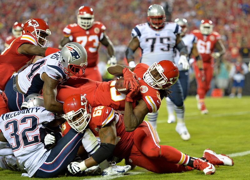 . Jamaal Charles #25 of the Kansas City Chiefs scores a touchdown against the New England Patriots during the second quarter at Arrowhead Stadium on September 29, 2014 in Kansas City, Missouri.  (Photo by Peter Aiken/Getty Images)