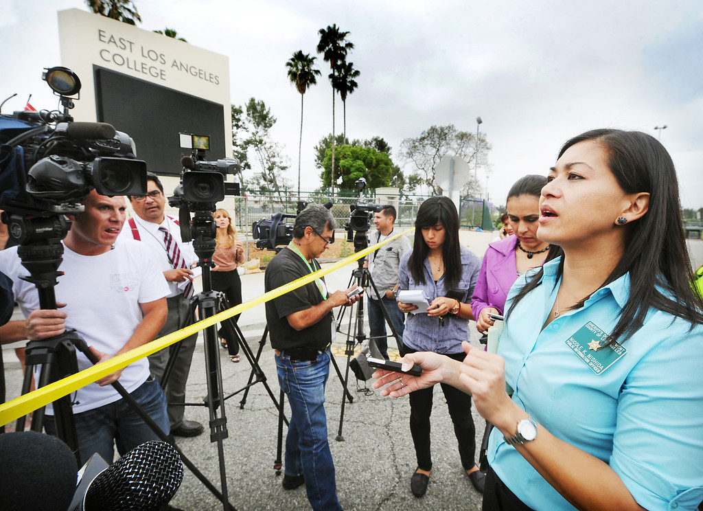 ". Los Angeles Sheriff\'s spokesperson, Nicole Nishida informing media on threat at East Los Angeles College.  A 19-year-old man was arrested for allegedly making phone calls to the California Highway Patrol threatening gun violence against local schools on Thursday, May 16, 2013. When the suspect called to make the threat, he said he was en route to a college in Monterey Park, she said. The call was made from a cell phone and was received from the East Los Angeles and Monterey Park areas, officials said.About 14 schools were locked down during the incident. At about 9:30 a.m., Santa Monica Community College police arrested a suspect, a 19-year old male in connection with this threat as well as the Santa Monica threat,"" Los Angeles County Sheriff\'s spokeswoman  The suspect was arrested on the Santa Monica campus and it was unclear if he had any weapons.(SGVN/Photo by Walt Mancini)"
