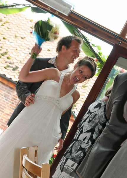 A bride and groom welcomed in for their wedding breakfast at Dairy Barns