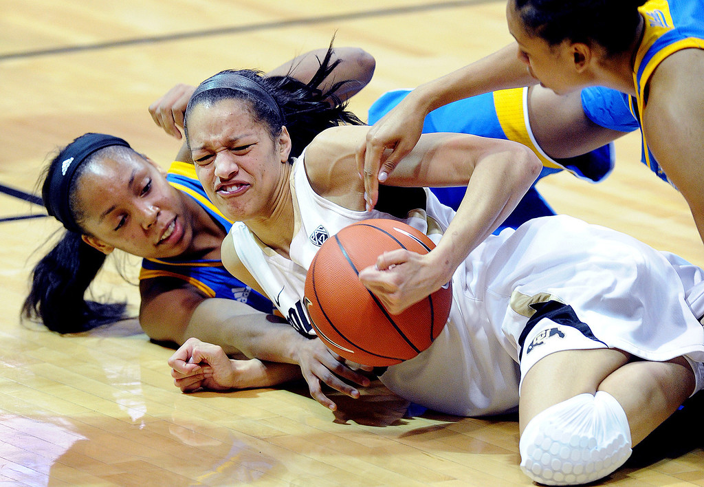 . UCLA\'s Nirra Fields, left, and Colorado\'s Arielle Roberson scramble for a loose ball during the second half of an NCAA college basketball game Friday, Feb. 28, 2014, in Boulder, Colo. Colorado won 62-42. (AP Photo/Daily Camera, Cliff Grassmick)