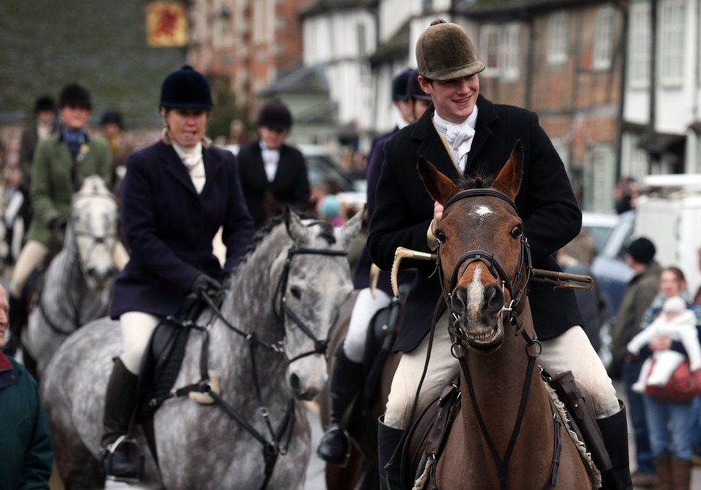 Description of . Riders with the Avon Vale Hunt, follow the hounds as they ride out for their traditional Boxing Day hunt, on December 26, 2012 in Lacock, England. As hundreds of hunts met today, Environment Secretary Owen Paterson claimed that moves to repeal the ban on hunting with dogs in England and Wales may not happen in 2013, although he insisted it was still the government's intention to give MPs a free vote on lifting the ban.  (Photo by Matt Cardy/Getty Images)
