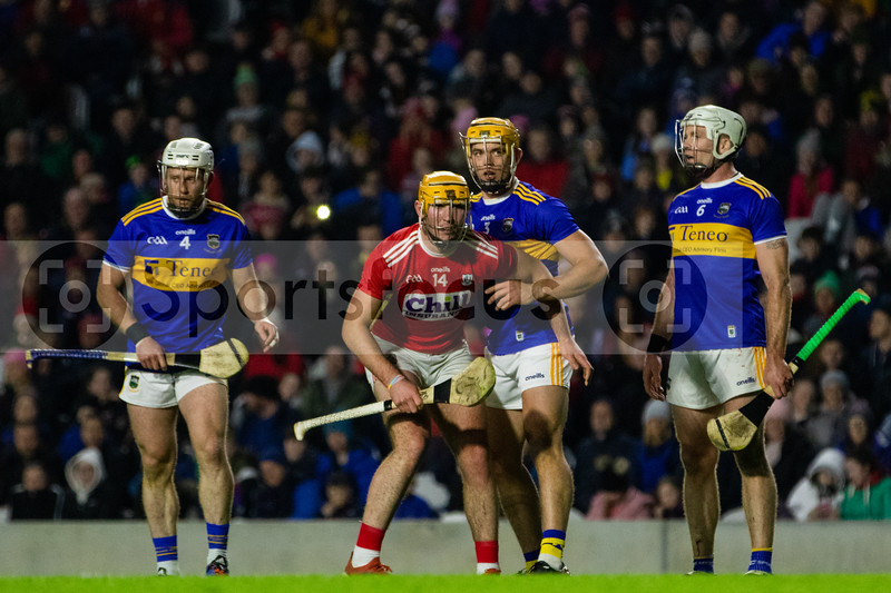 Tipperary's Sean O'Brien, Ronan Maher and Padraic Maher wait for the penalty to be taken along with Cork's Declan Dalton