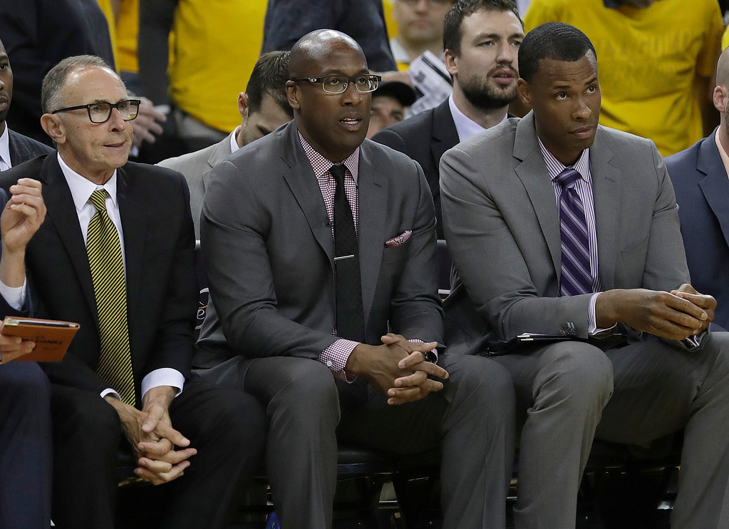 . Golden State Warriors interim head coach Mike Brown, center, sits between assistant coaches Ron Adams, left, and Jarron Collins during the first half of Game 1 of basketball\'s NBA Finals against the Cleveland Cavaliers in Oakland, Calif., Thursday, June 1, 2017. (AP Photo/Marcio Jose Sanchez)