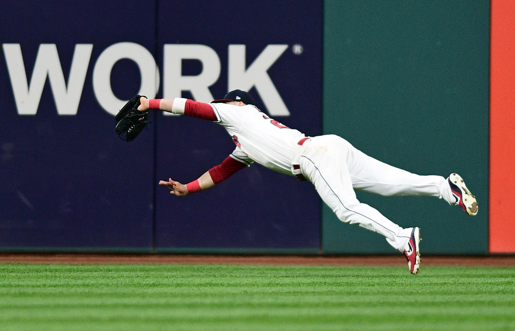 . Cleveland Indians\' Jason Kipnis catches a fly ball hit by New York Yankees\' Chase Headley during the third inning of Game 1 of a baseball American League Division Series, Thursday, Oct. 5, 2017, in Cleveland. (AP Photo/Phil Long)