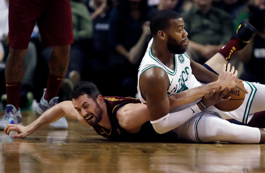 . Cleveland Cavaliers center Kevin Love, left, and Boston Celtics center Greg Monroe fight for a loose ball during the first half in Game 2 of the NBA basketball Eastern Conference finals, Tuesday, May 15, 2018, in Boston. (AP Photo/Charles Krupa)