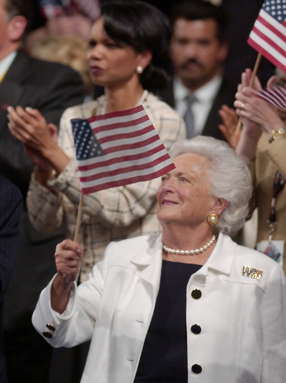 . Barbara Bush waves a flag, while national security advisor Condoleeza Rice applauds in the background, as President Bush speaks in Madison Square Garden, during the Republican National Convention in New York,Thursday, Sept. 2, 2004. (AP Photo/Ed Reinke)