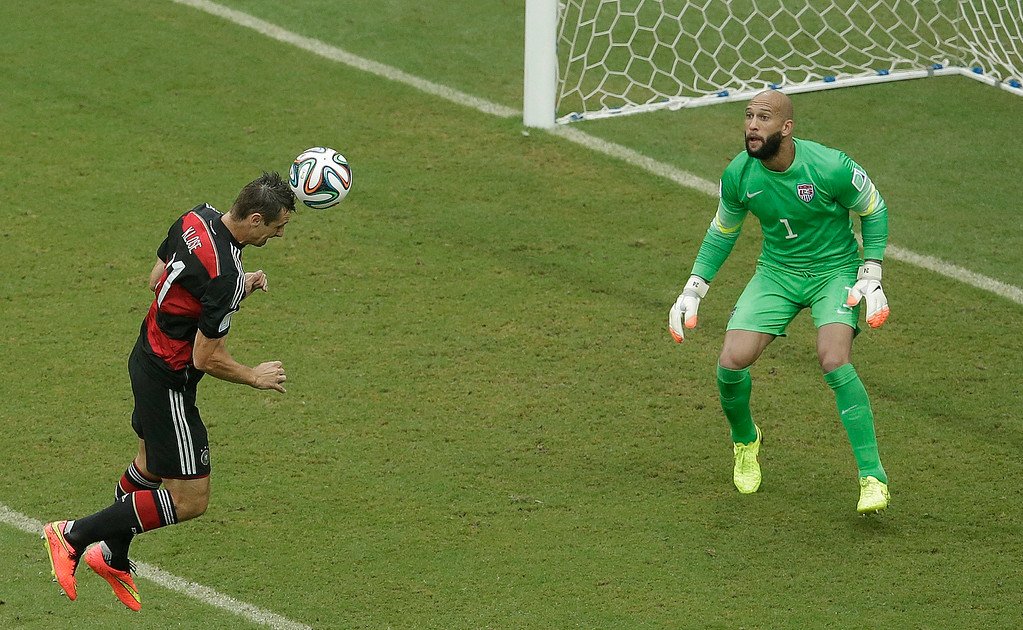 . Germany\'s Miroslav Klose heads the ball towards the goal which goes wide past United States\' goalkeeper Tim Howard during the group G World Cup soccer match between the USA and Germany at the Arena Pernambuco in Recife, Brazil, Thursday, June 26, 2014. (AP Photo/Hassan Ammar)