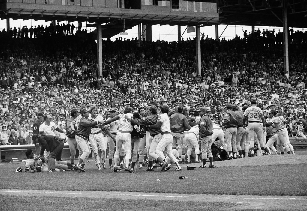 . Cincinnati Reds and Chicago Cubs players exchange punches after a free-for-all erupted during second inning of their game in Chicago, May 27, 1984.  The game was delayed 32 minutes after the umpires reversed themselves on a decision. At left, an umpire tries to break up Reds\' Mario Soto and an unidentified Cubs player. (AP Photo/Fred Jewell)