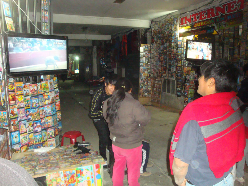 The main street was full of grimy little stalls with people trying to sell anything and everything to make a little money to survive. This DVD seller is showing a bullfighting video, demonstrating the very basic to non-existant level of education and animal welfare awareness of the majority of people here.