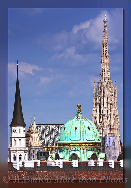 Vienna Empor Michaelerkirche, Michaelerplatz dome, and St. Stephen's Cathedral over the rooftop of one of the wings of the Hofburg imperial palace.