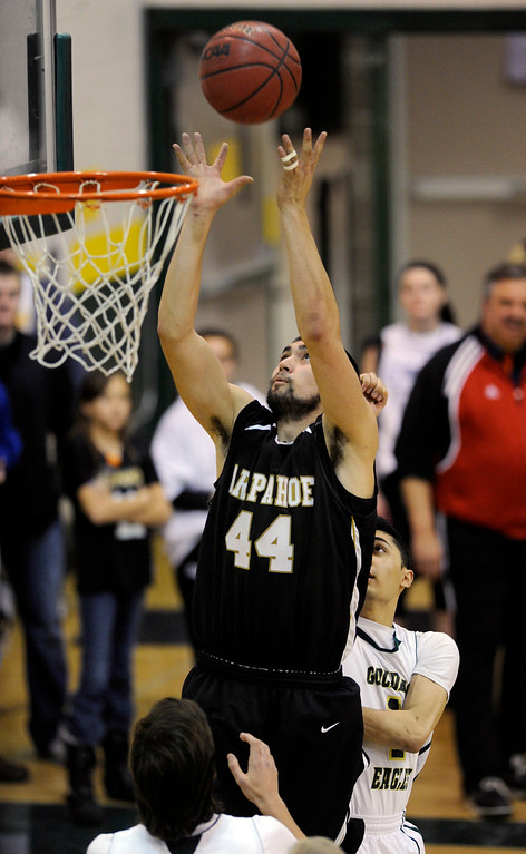 . Warriors senior post Matt Glasscock (44) converted an offensive rebound in the second half. The Mountain Vista High School boy\'s basketball team defeated Arapahoe 69-54 Friday night January 4, 2013.  Karl Gehring/The Denver Post