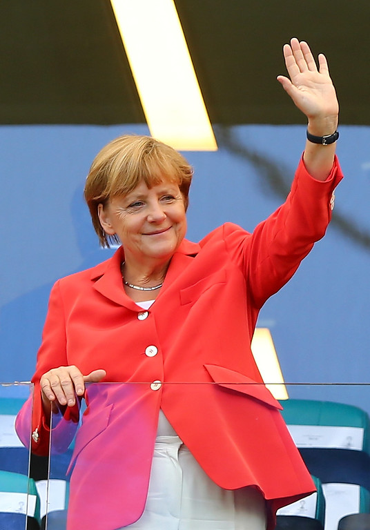 . German Chancellor Angela Merkelwaves during the 2014 FIFA World Cup Brazil Group G match between Germany and Portugal at Arena Fonte Nova on June 16, 2014 in Salvador, Brazil.  (Photo by Martin Rose/Getty Images)