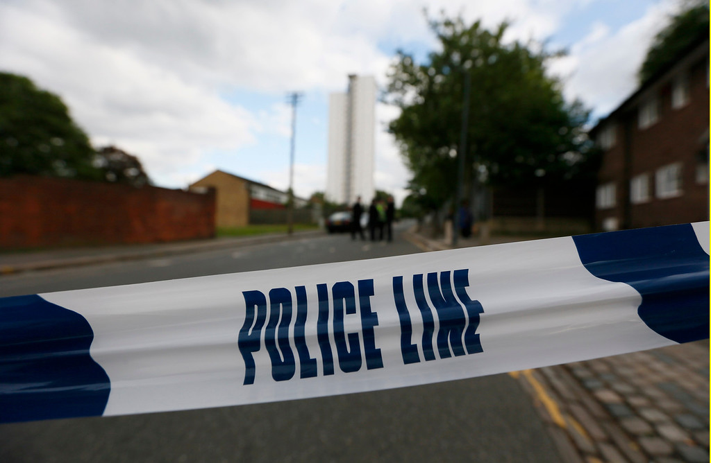 . Police tape marks a cordon set up around a crime scene where one man was killed in Woolwich, southeast London May 22, 2013.  REUTERS/Stefan Wermuth