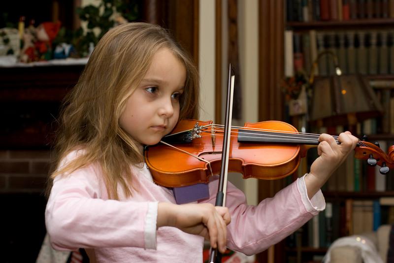 Arayana playing her violin.