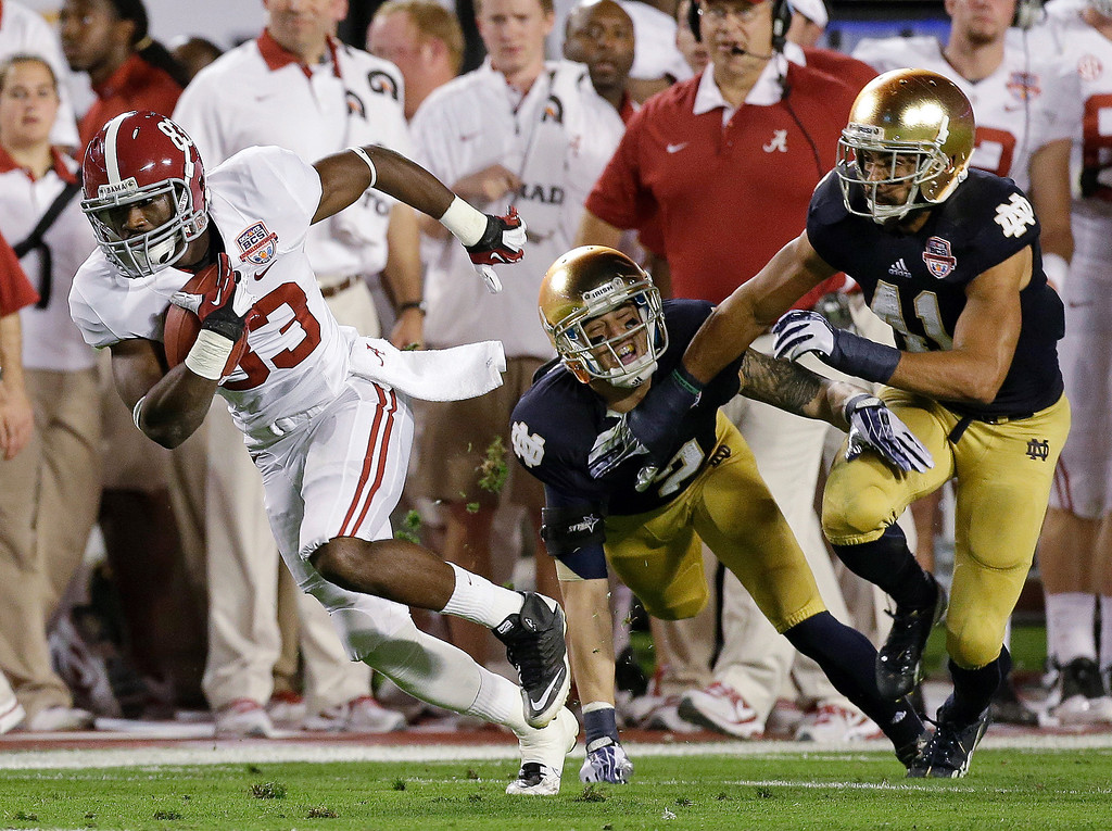 . Alabama\'s Kevin Norwood (83)catches a pass in front of Notre Dame\'s Bennett Jackson (2) and Matthias Farley (41) during the first half of the BCS National Championship college football game Monday, Jan. 7, 2013, in Miami. (AP Photo/Chris O\'Meara)